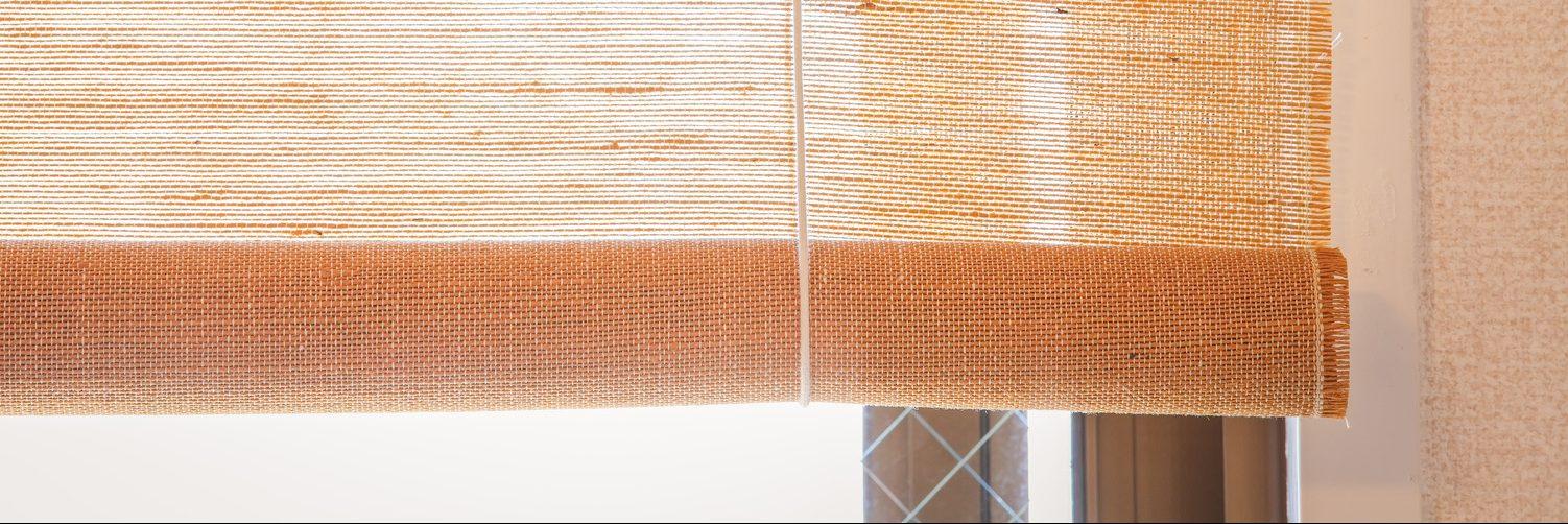 Brown fabric window blind in living room 1500_500